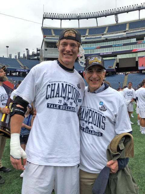 Ben Reeves and Peter Salovey after Yale men's lacrosse won its first NCAA championship